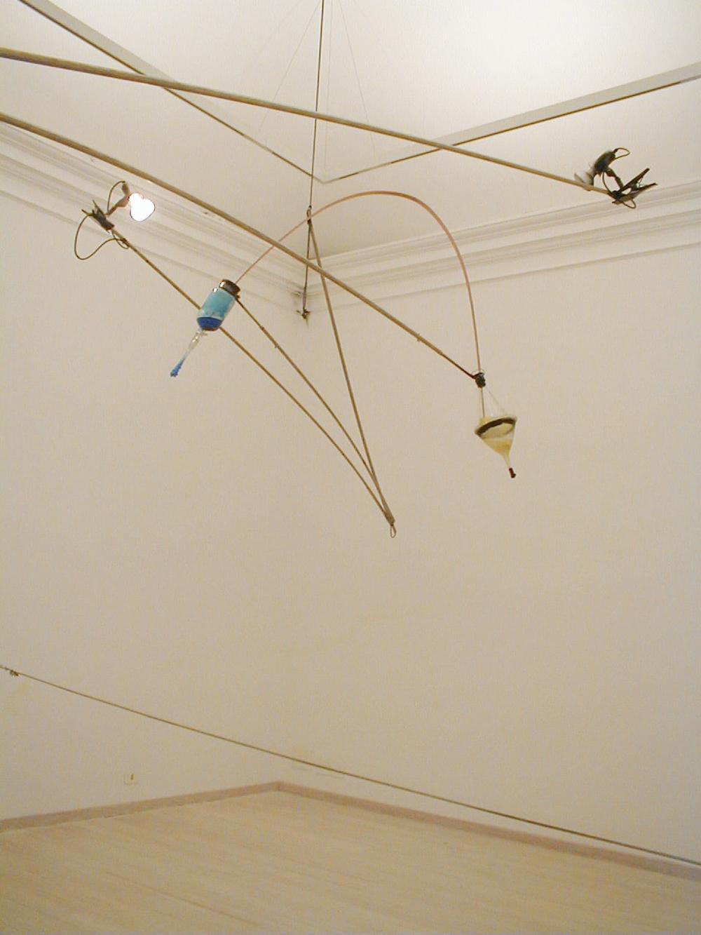 Marzio e Mariano, 2002, inox, pirex, rame, lampade, solfato di rame, fosforo, sale, timer, dimensione ambiente